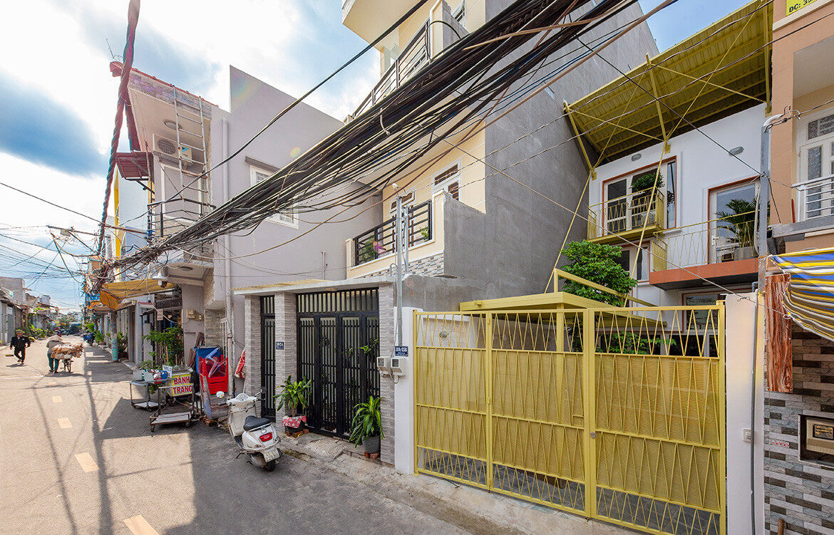 Double Roof House by Khoun Studio cc Thiet Vu streetscape