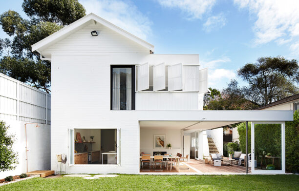 Mosman House by Alexander and Co. is a contemporary garden pavilion addition to a quaint cottage house.