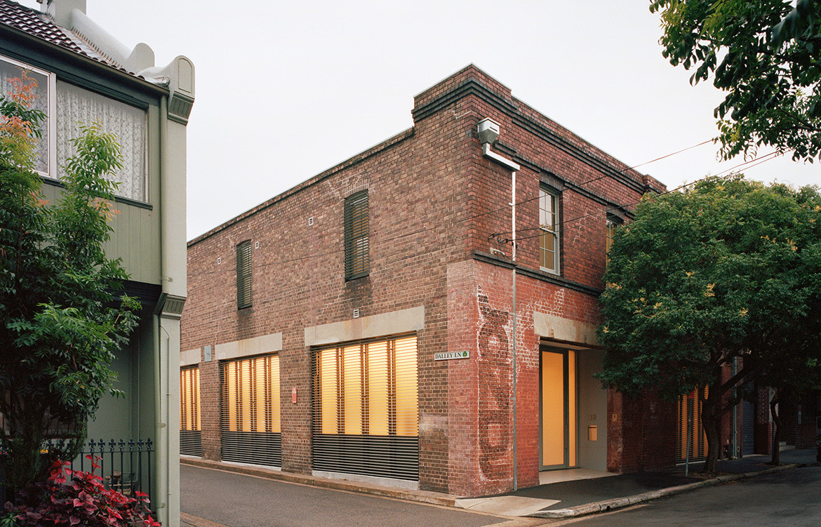 Brick warehouse in Redfern Sydney converted into a four bedroom family house with a laboratory and 10 car garage by Ian Moore Architects