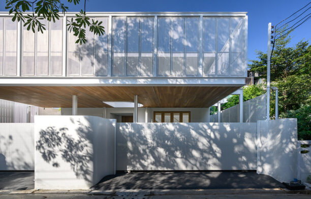 Operable shutters of perforated white steel form the stunning façade of With.It House by BodinChapa Architects featured in What's Within With.It House? on habitusliving.com cc Rungkit Charoenwat