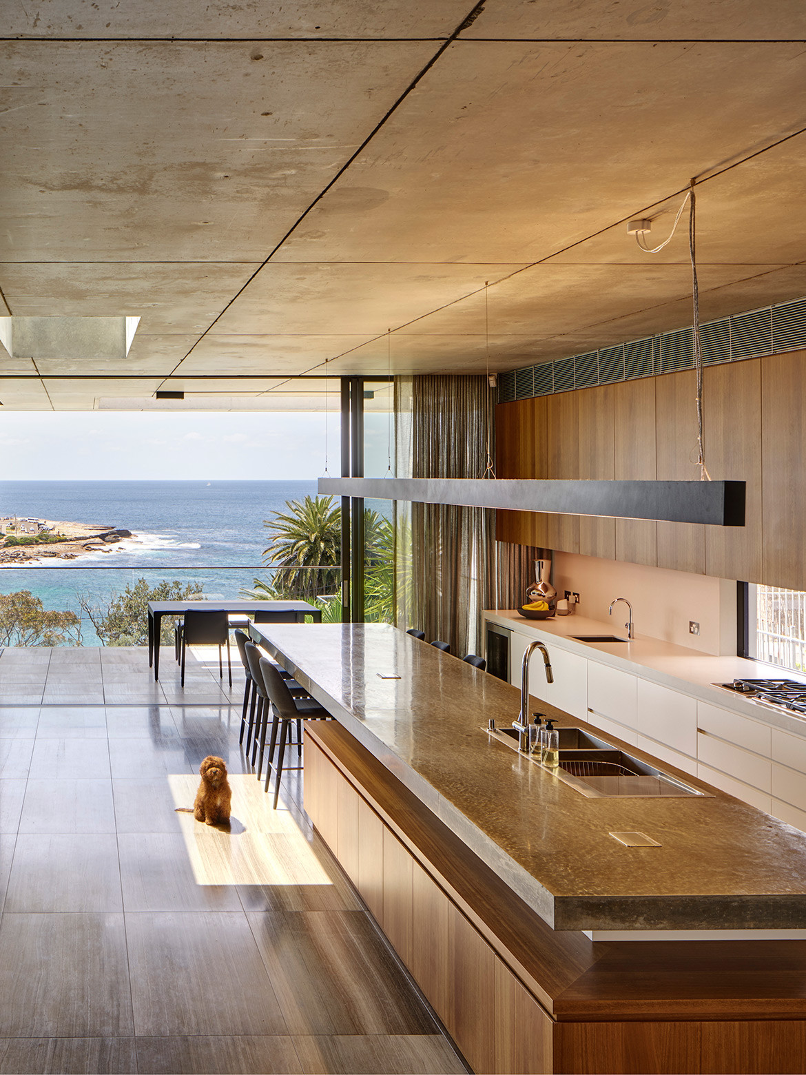 Worldstone Cesar White marble floor tiles complements the concrete ceiling of Gordons Bay House by PopovBass featured in Beautifully Brutalist Interiors Of Houses Across Asia Pacific on habitusliving.com cc Michael Nicholson