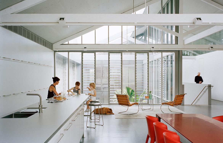 Open plan modern minimalist kitchen design in Redfern Warehouse by Ian Moore Architects