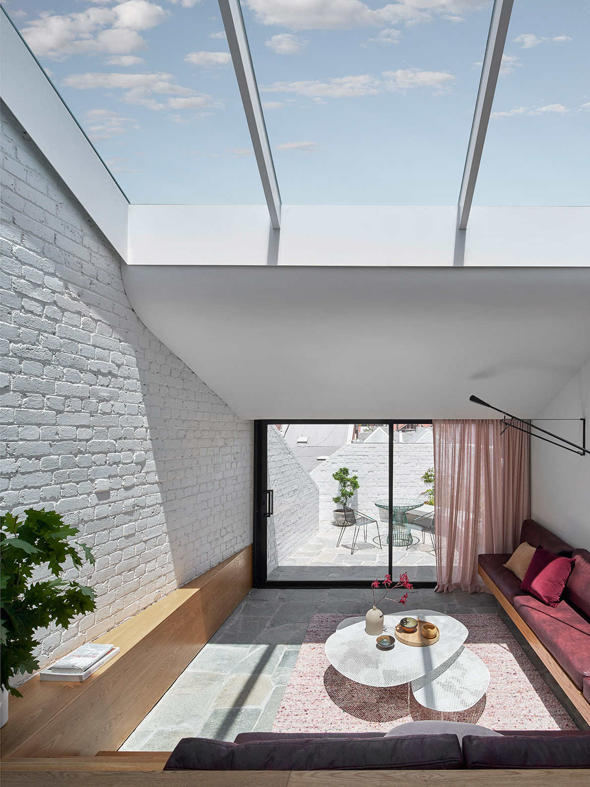 In order to make the most of this Melbourne residence's blessed northerly aspect, Taylor Knights literally flipped the traditional layout of Fitzroy Terrace on its head.