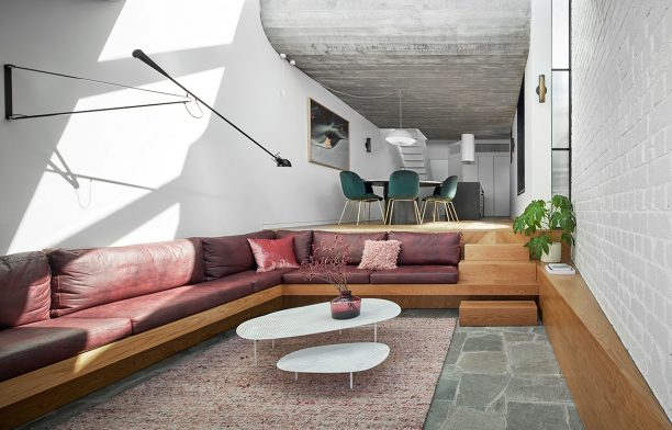 An expansive skylight shines natural light down into the immersive sunken lounge of Fitzroy Terrace by Taylor Knights