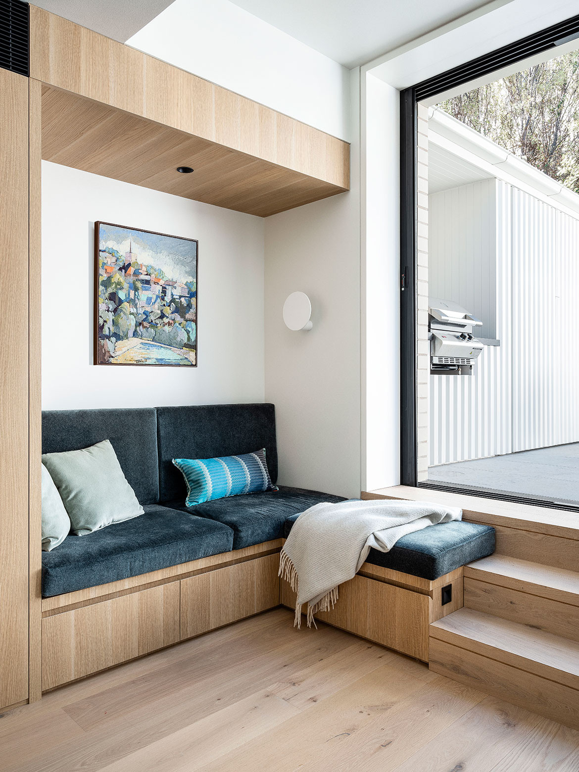 Seating nook with under-bench storage in corner of the kitchen in Paddington Terrace by Porebski Architects