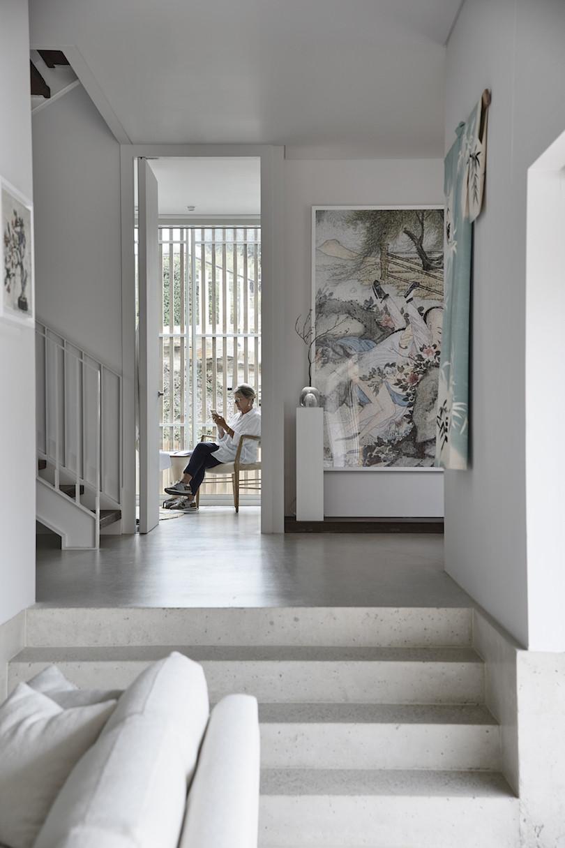 A woman sits inside Franklin by Ola Studio