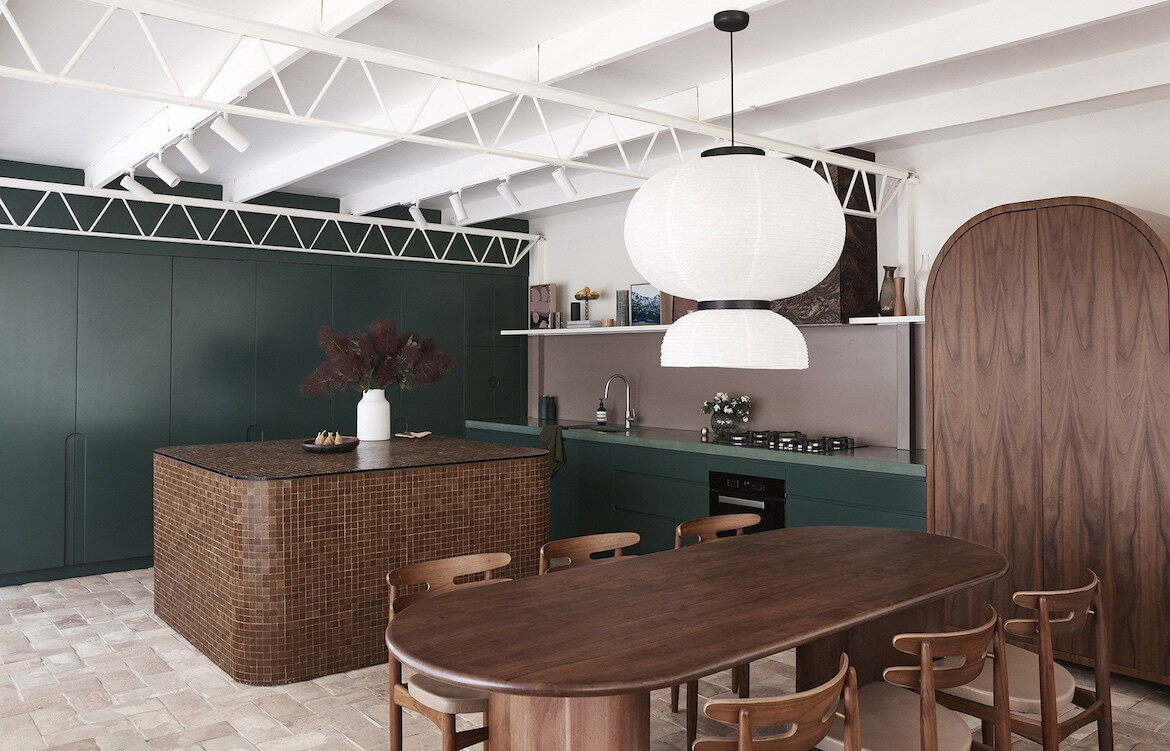 A dark green and timber kitchen emulates the surrounding bushland. Wahroonga House by Tom Mark Henry.