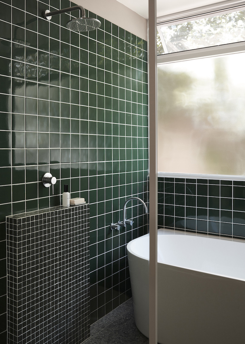 Bathroom with green tiles and white grout in the Wahroonga House by Tom Mark Henry.