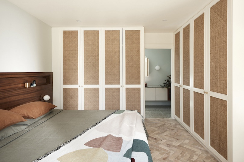 Bedroom with built in white and brown cupboards and terracotta floors inBathroom with green tiles and white grout in Wahroonga House by Tom Mark Henry.