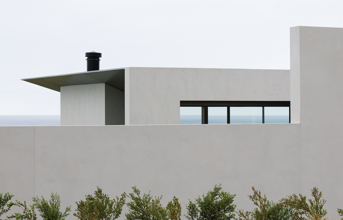 A glimpse of the ocean is visible from the exterior entrance to Carr Peninsula House.