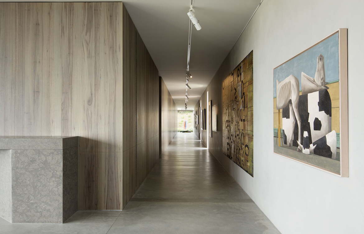 Carr designed a hallway gallery for the client's art in Peninsula House.
