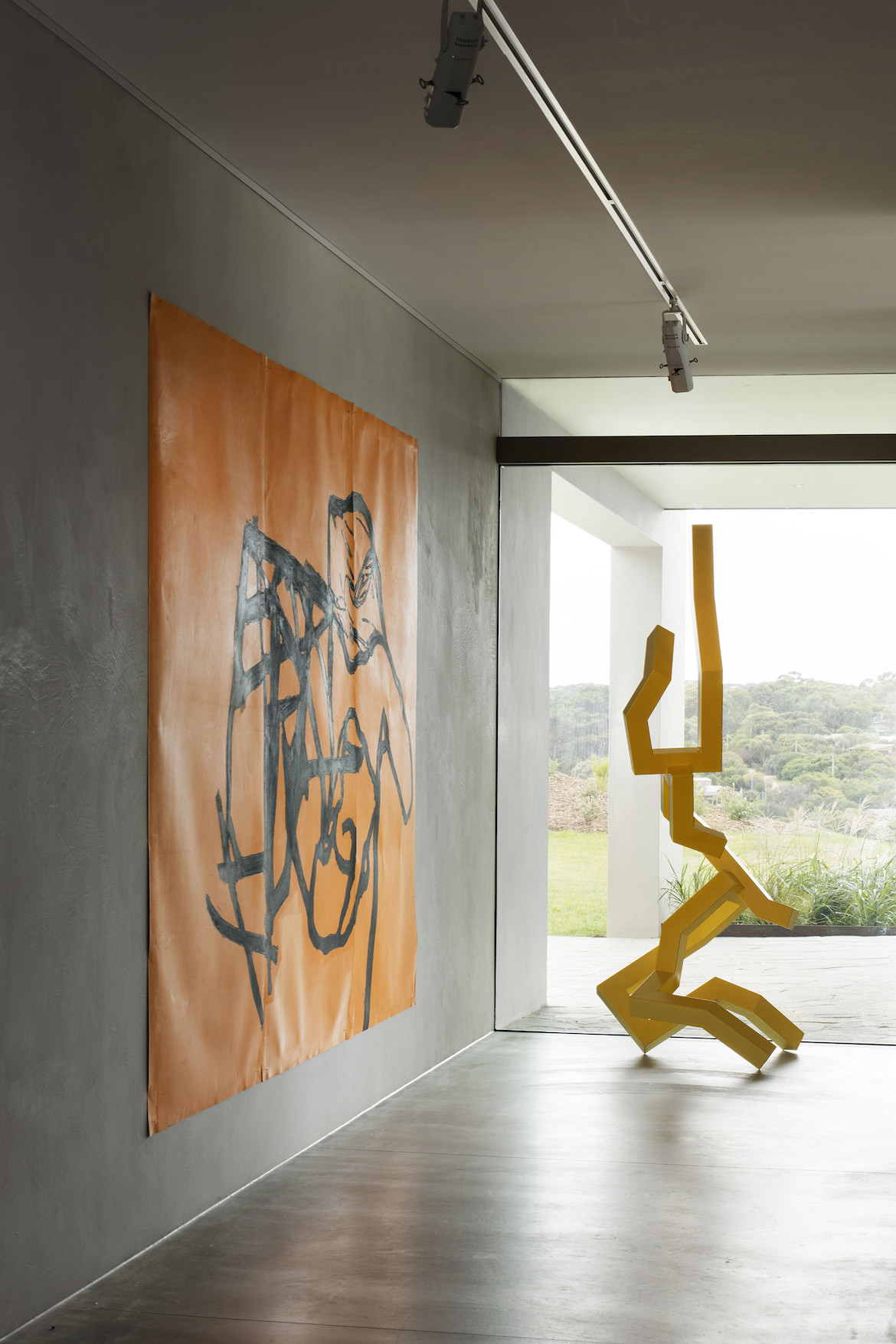 Contemporary orange black and yellow art in Peninsula House.