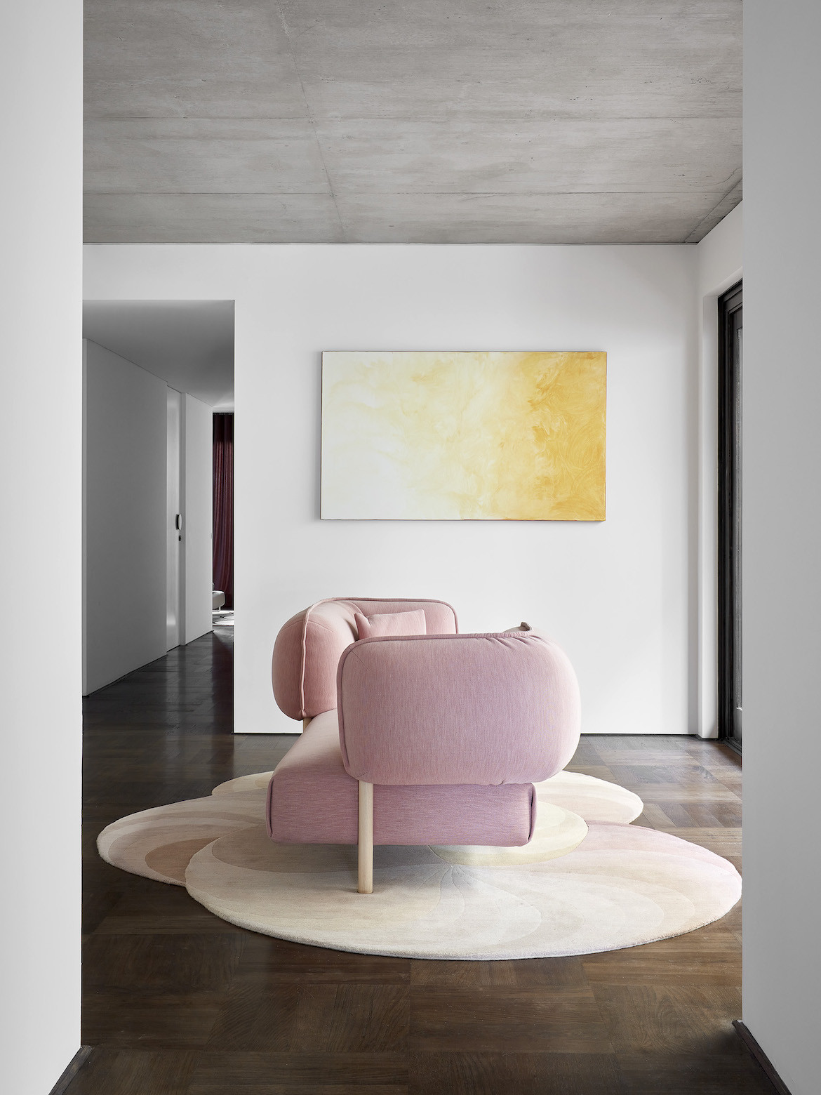 A pink modular sofa sits on Slinkie rug in State of Kin's Shutter House