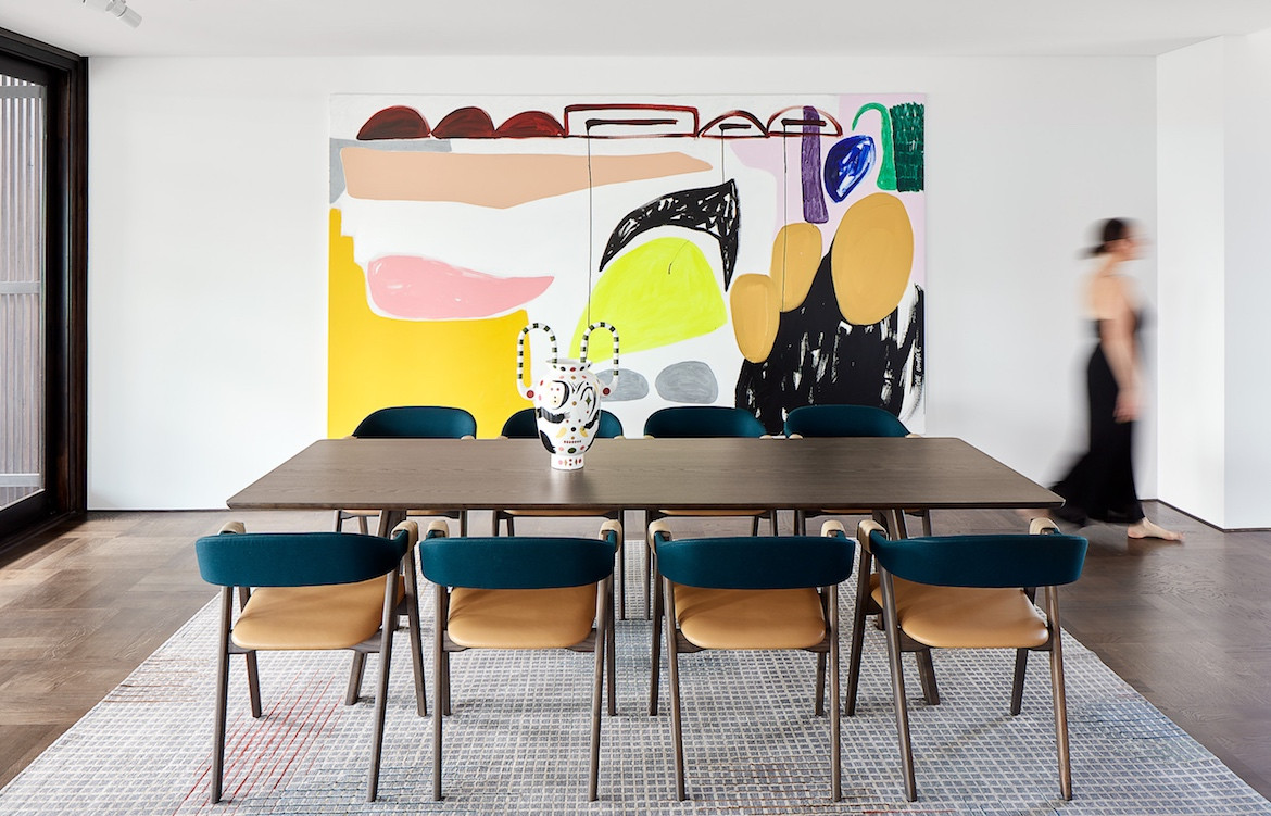 The dining table and a colourful artwork in State of Kin's Shutter House