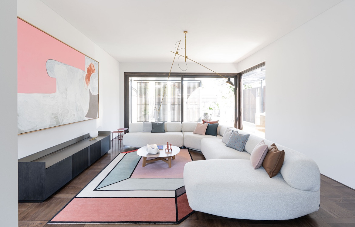A white couch and rug by Patricia Urquiola State of Kin's Shutter House