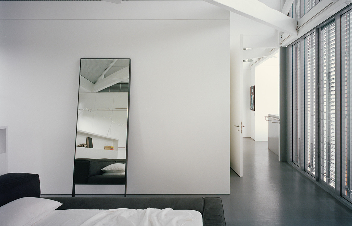 Modern minimalist interior design aesthetic in bedroom of Redfern Warehouse by Ian Moore Architects
