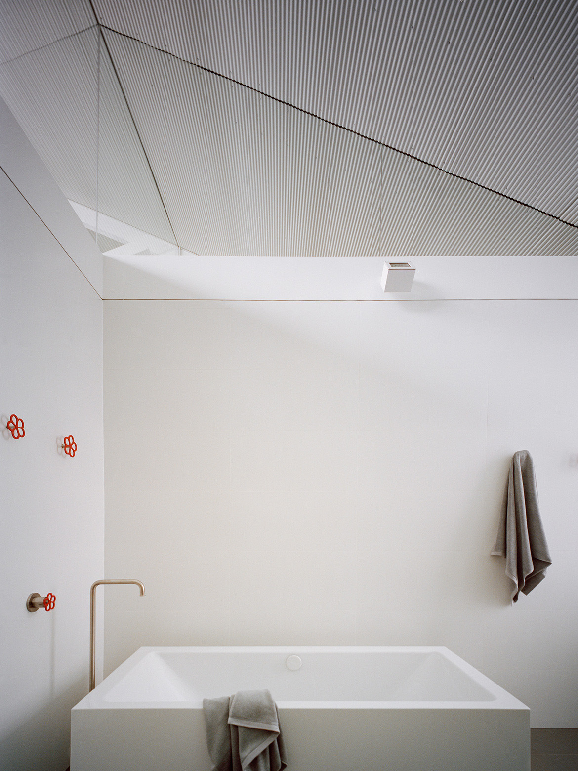 Modern industrial minimalist interior design aesthetic in bathroom of Redfern Warehouse by Ian Moore Architects