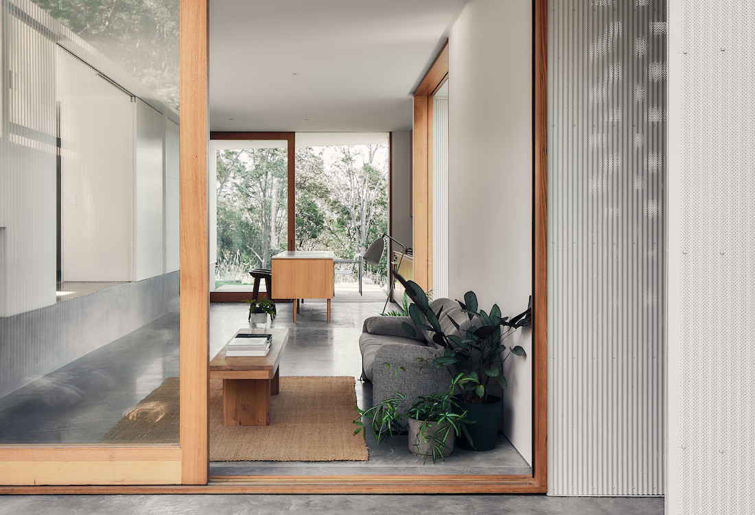 Sliding doors open at each end of the A-CH's Yandina Sunrise home.