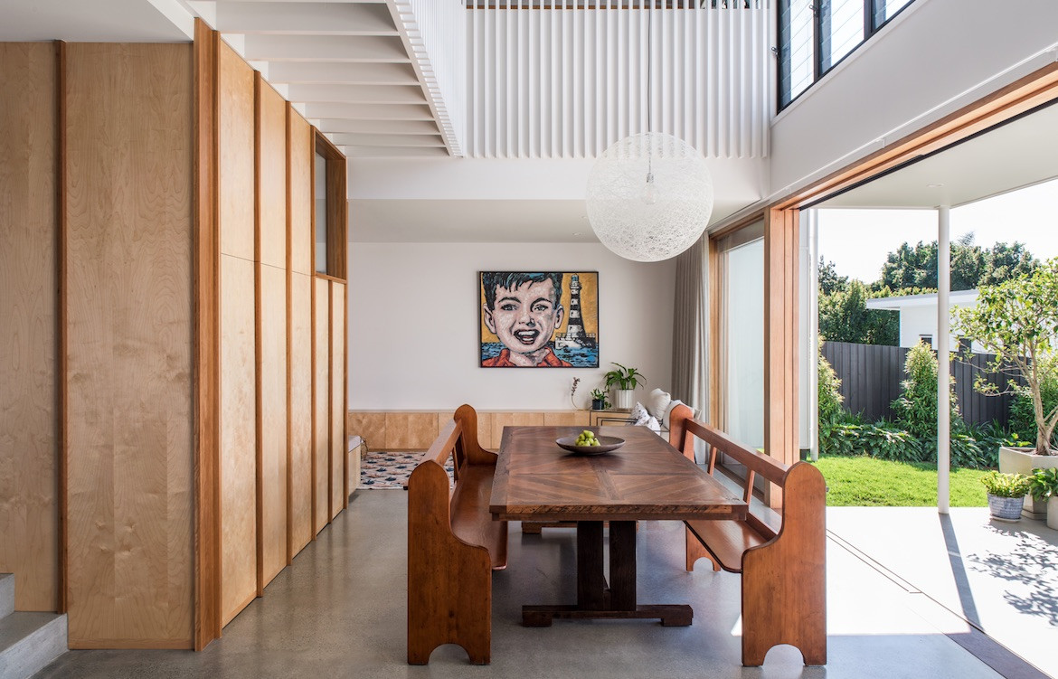 Church pews and large dining table in Northgate, Brisbane Queenslander by Bones Studio and Room by Room