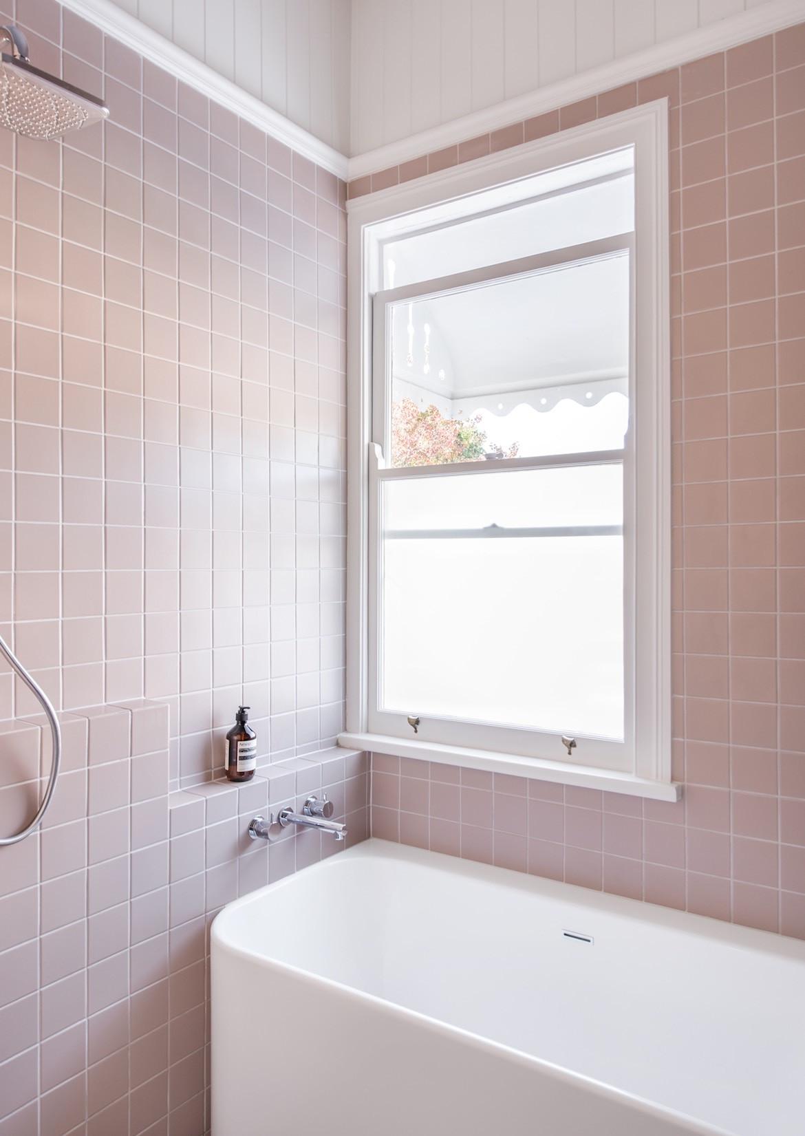 The pale pink bathtub in the Queenslander bathroom.