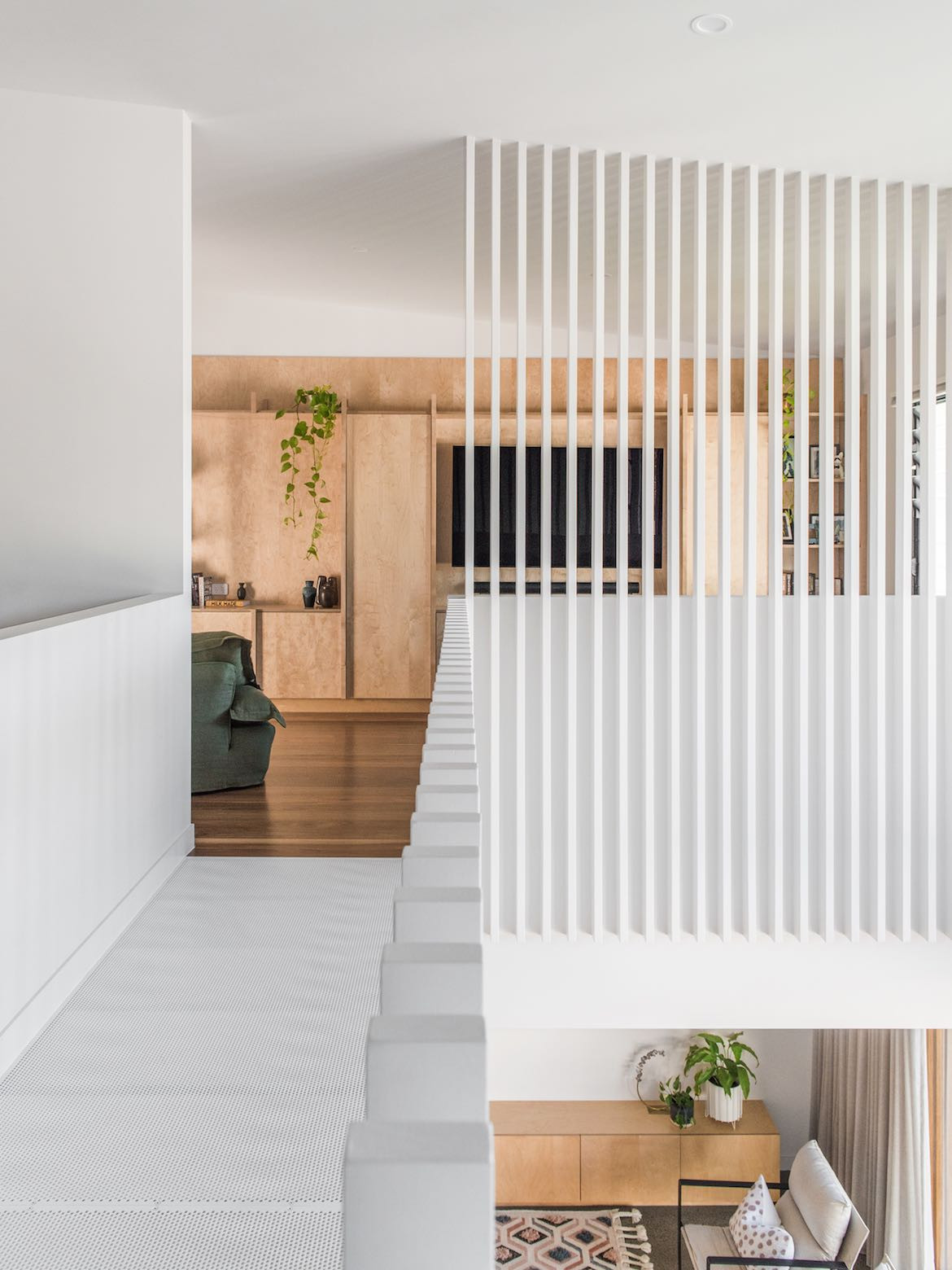 Vertical beams demarcate the upstairs living area.
