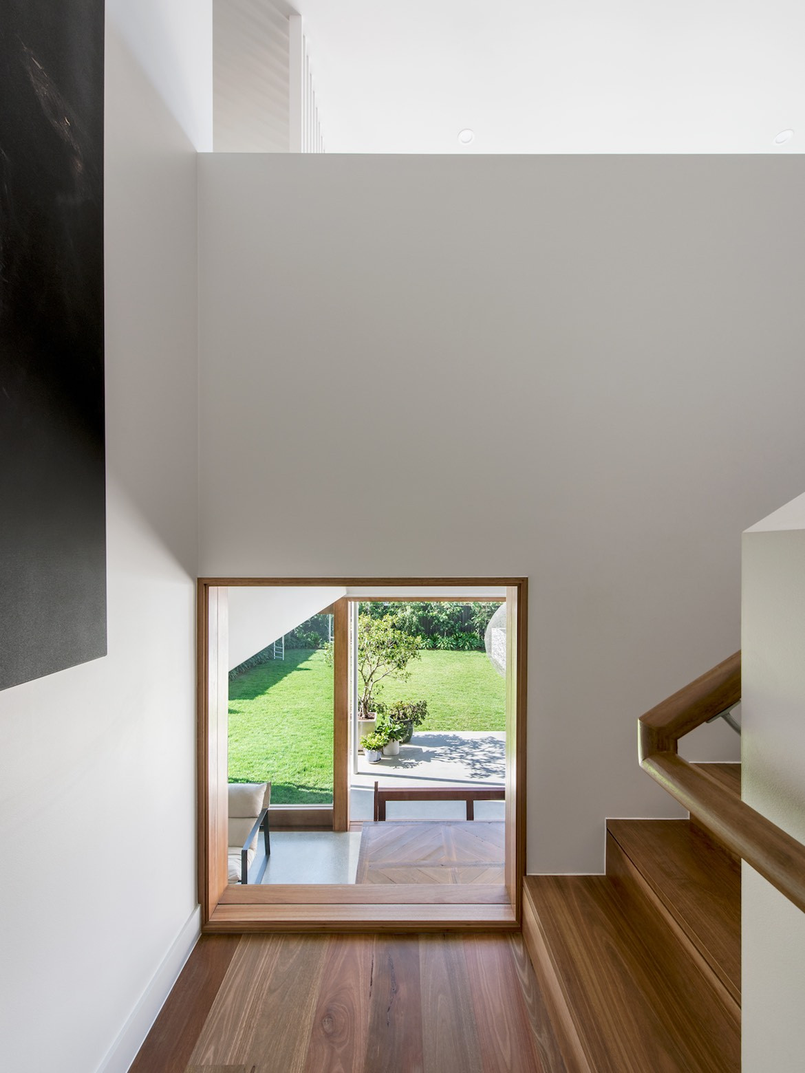 A platform on the stairs of the Queenslander is used to feature the clients' artwork.