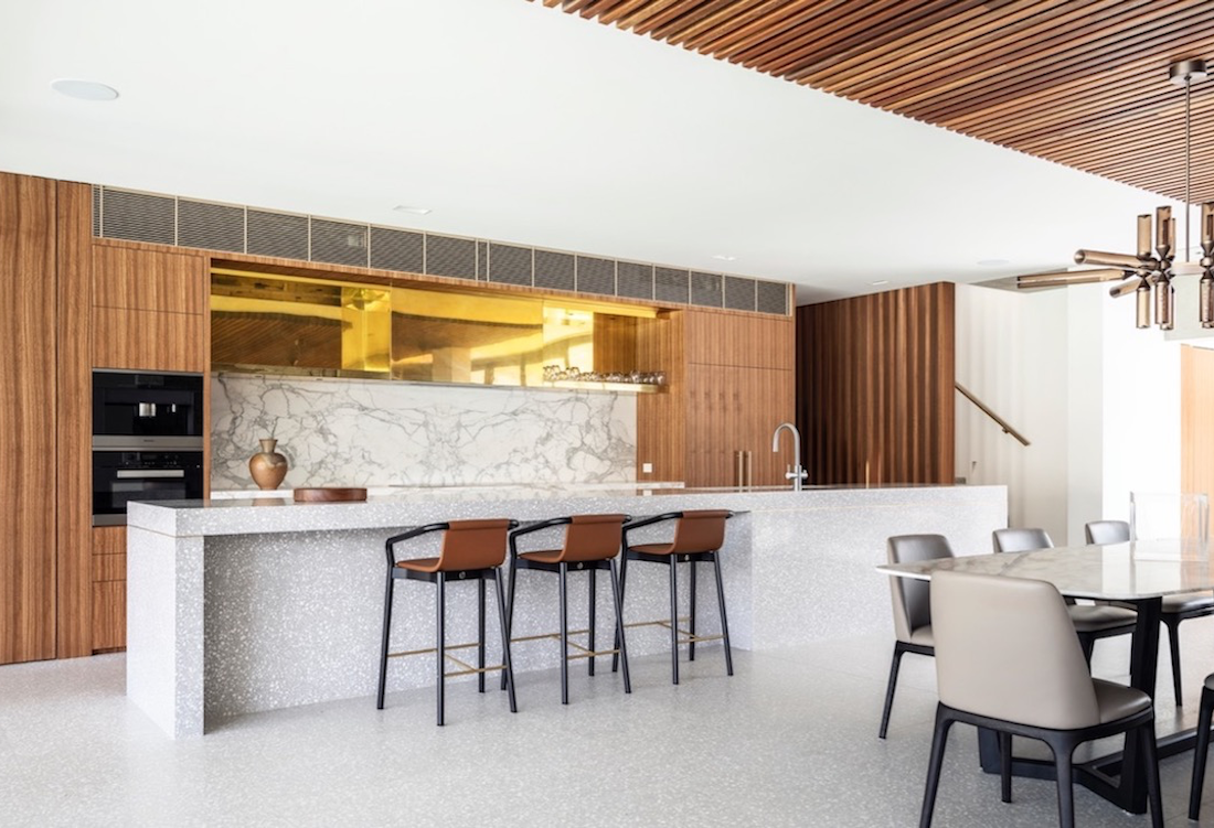 The kitchen's bespoke terrazzo island bench and sustainable timber veneer cabinetry.