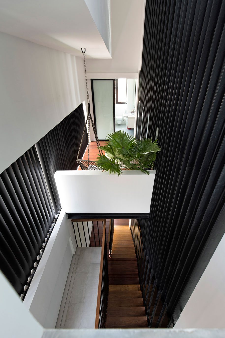 5-view-from-3rd-sty-towards-bedroom-2-side-balcony-and-stairs
