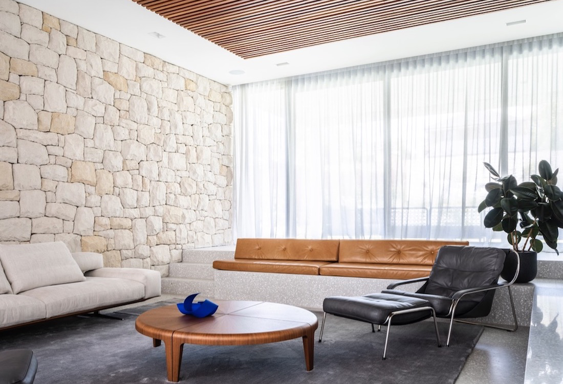 Living room with stone wall