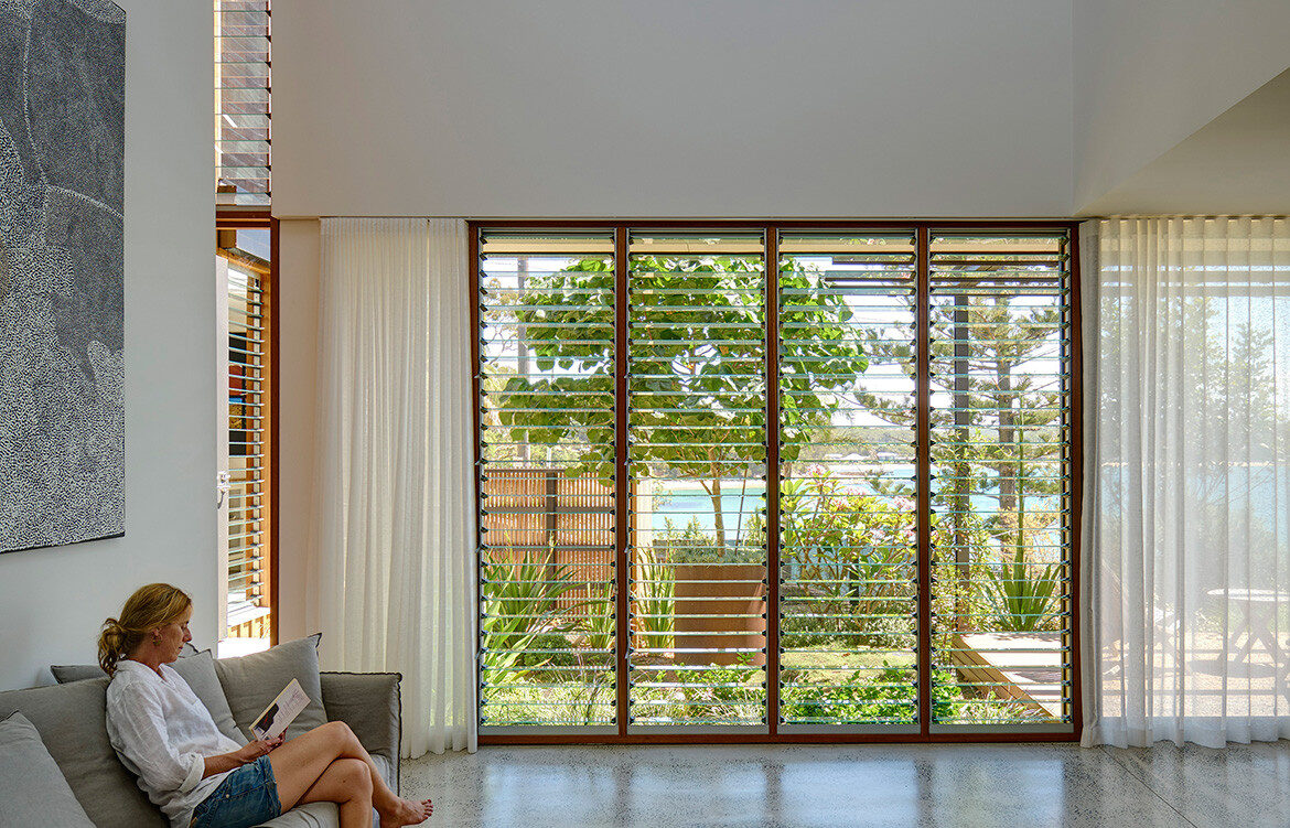 Breezway glass louvre windows maximise ventilation in Bundeena Beach House by Grove Architects