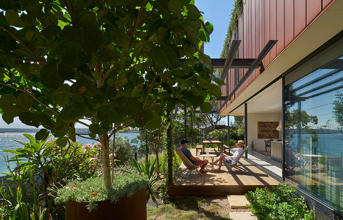 The Corten-clad and timber-clad structures of Bundeena Beach House by Grove Architects form a durable house, well-connected with its environment.