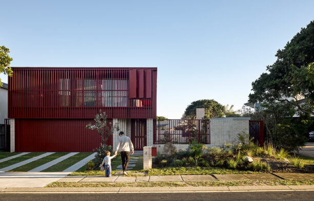 Casuarina House by Vokes and Peters is a stunning modern house in Brisbane, Australia, characterised by white brick, a battened screen façade and Garden City Movement values.