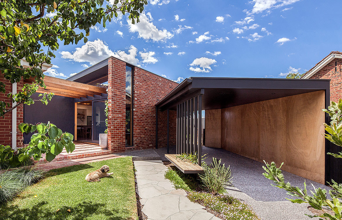 Baker Drofenik Architects leverages the honest bones of a red brick home into a contemporary family home.