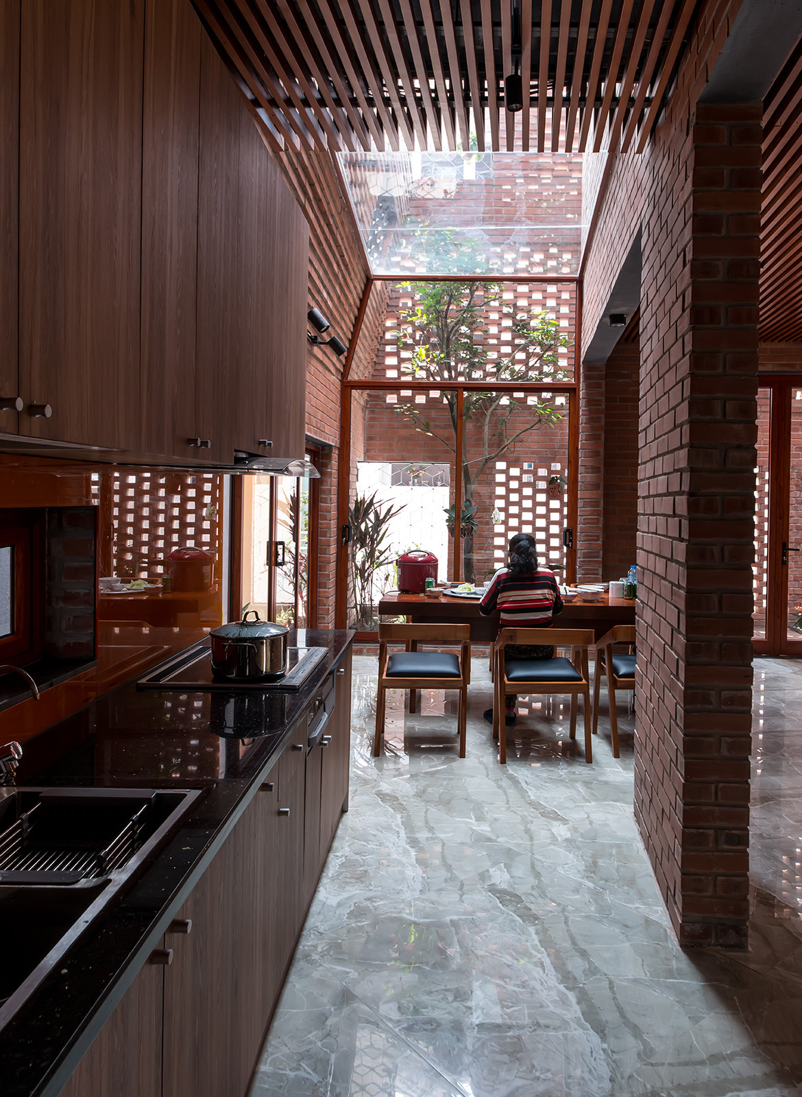 Brick Cave H&P Architects Nguyen Tien Thanh kitchen dining open