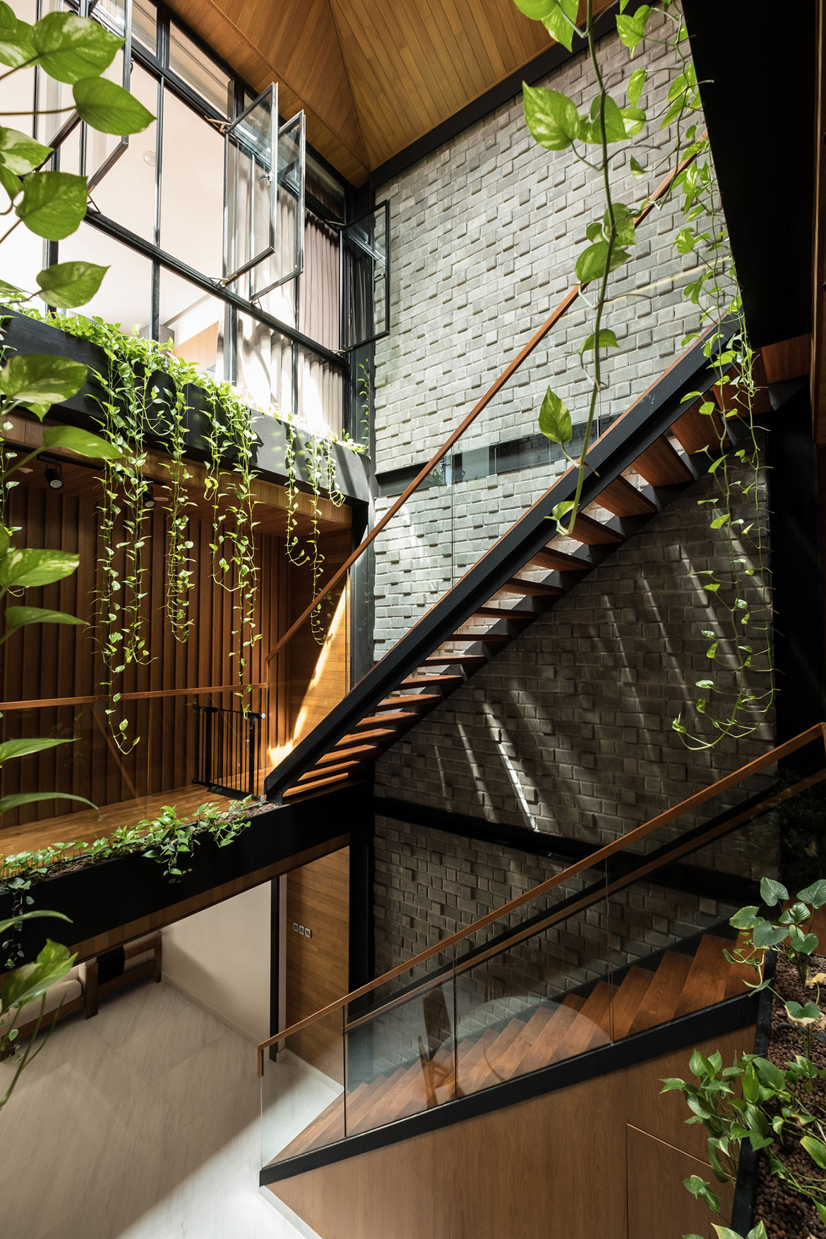 Produce Singapore family home stairs and courtyard