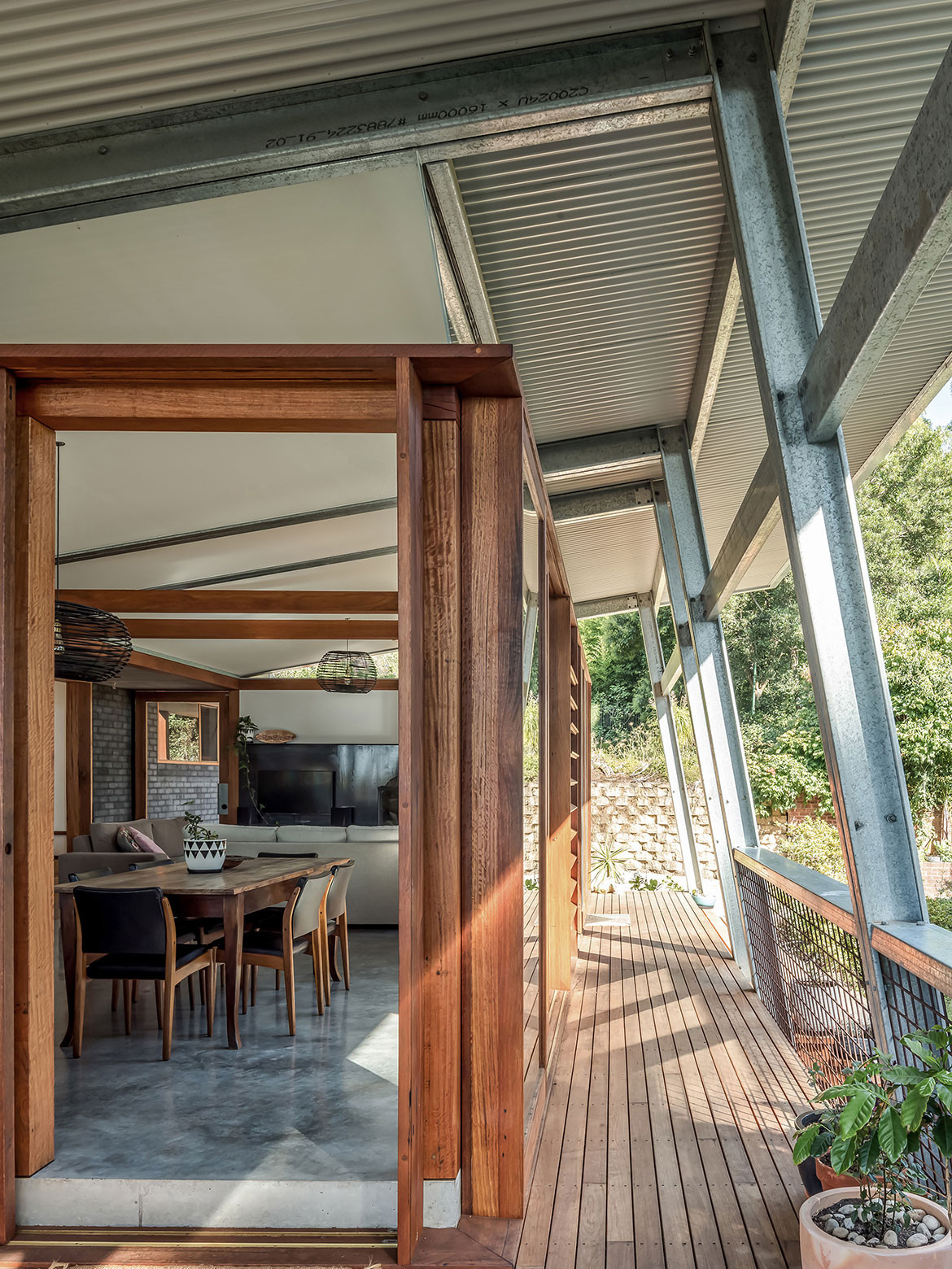 Studio Takt added a north facing living pavilion to a dark, cramped 1950s brick bungalow in Illawarra, NSW, toopenExoskeleton House up to the northerly aspect and connect it to its landscape.