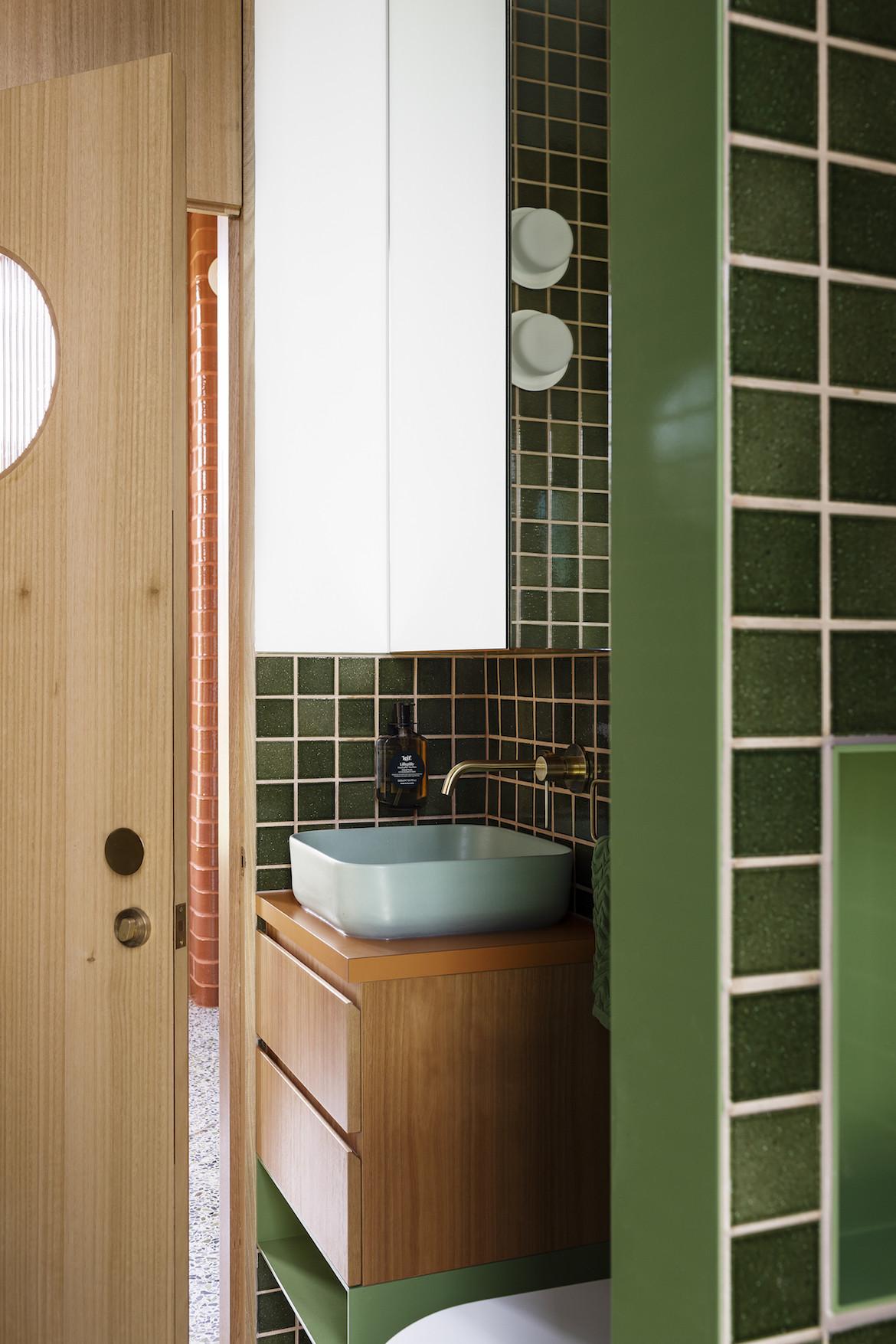 Green tiled bathroom.