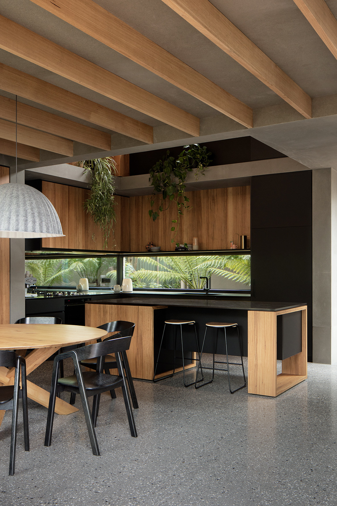 Kitchen island and circular dining table with black features.