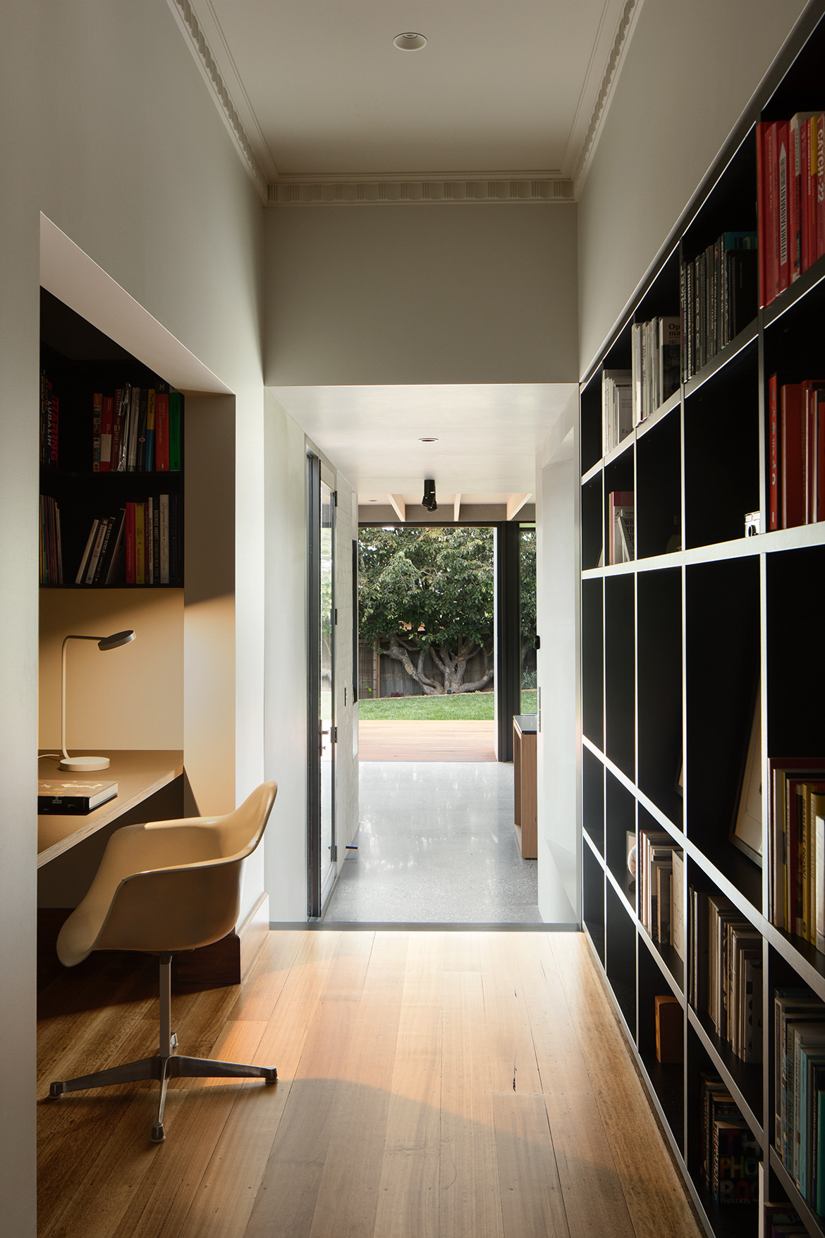 Hallway with reading nook and shelves.
