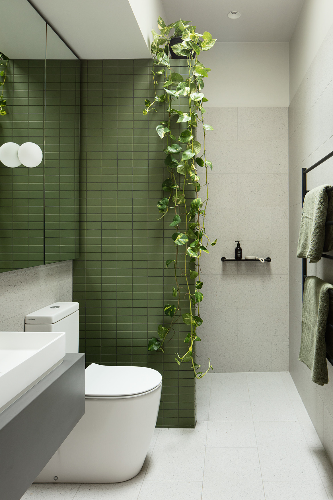 Green and white tiled bathroom.