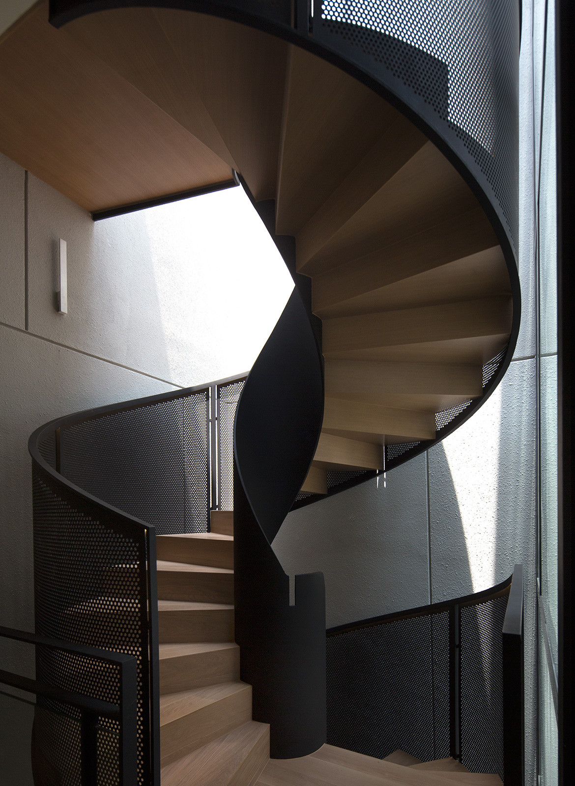 House with Loggia RT+Q Architects CC Albert Lim winding staircase perforated balustrade