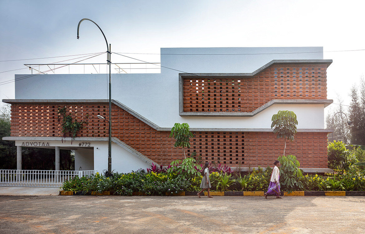 The brutalist exterior of Inside Out House by Gaurav Roy Choudhury Architects has a brutalist exterior with breeze blocks