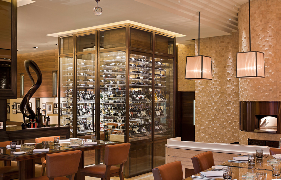 Jojo-St-Regis-18-dining-area-with-wine-room-and-pizza-oven