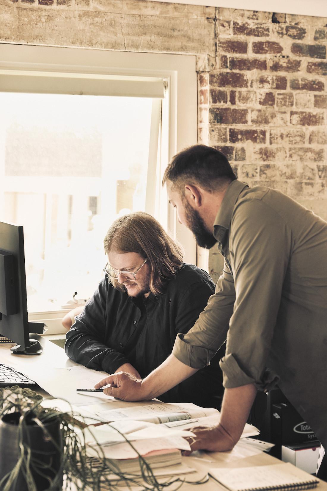 Two men talk in the Kett design studio
