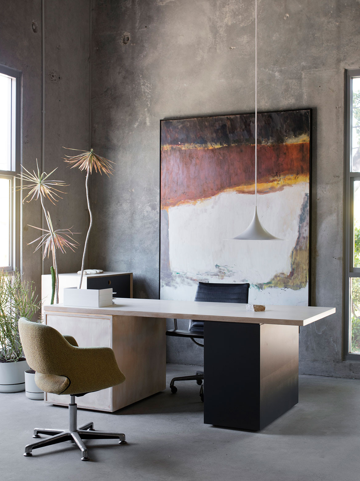 Rendered concrete walls give this Marrickville Warehouse conversion by Adele McNab a minimalist, industrial aesthetic.