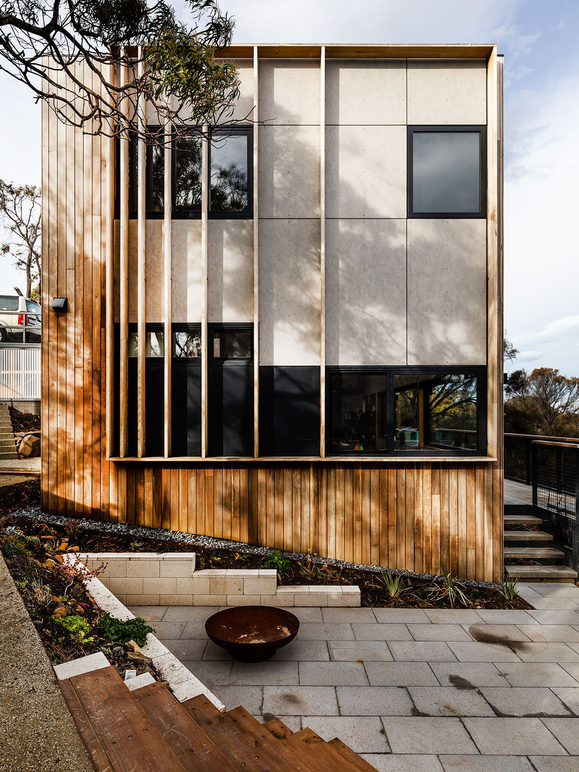 Cumulus Studio's brief for Midway Point House, in Tasmania, requested privacy from the street while also capturing northern sun, and to make the most of western views but minimise glare and heat gains / loss.