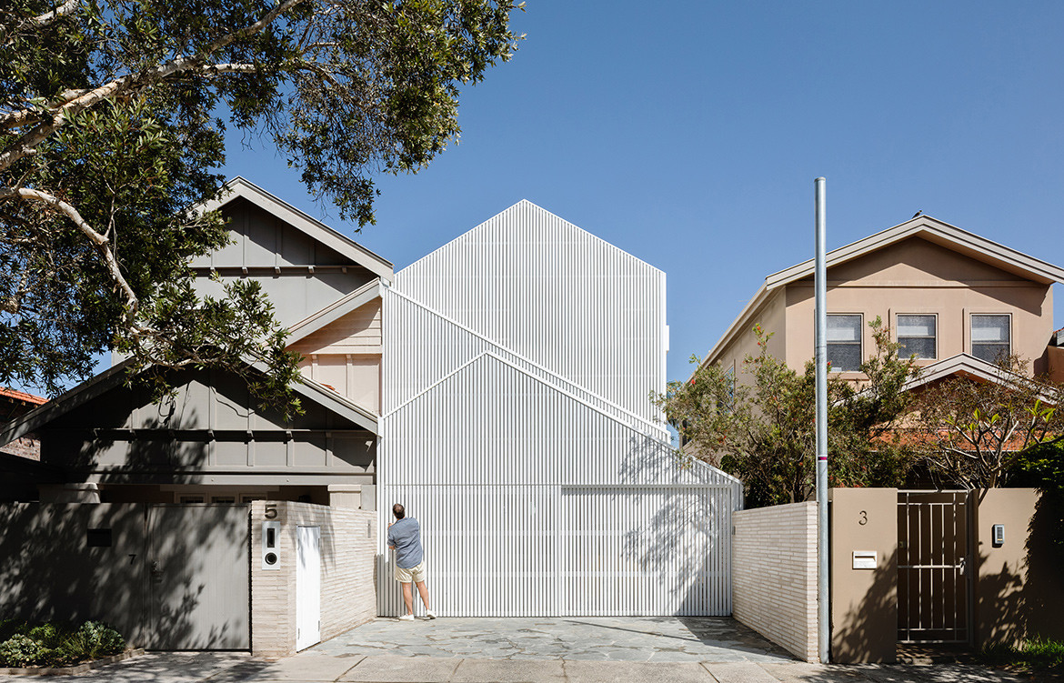 A bungalow in Bondi renovated by James Garvan Architecture into a modern minimalist house with a impressive facade