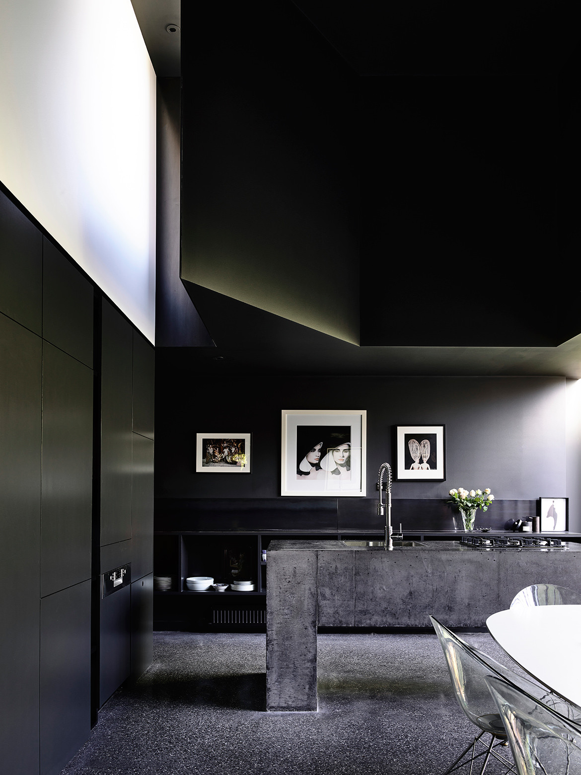 Powell Street House's kitchen design by Robert Simeoni has the aesthetic of an art gallery with the work of fashion photographer Robyn Beeche on display.