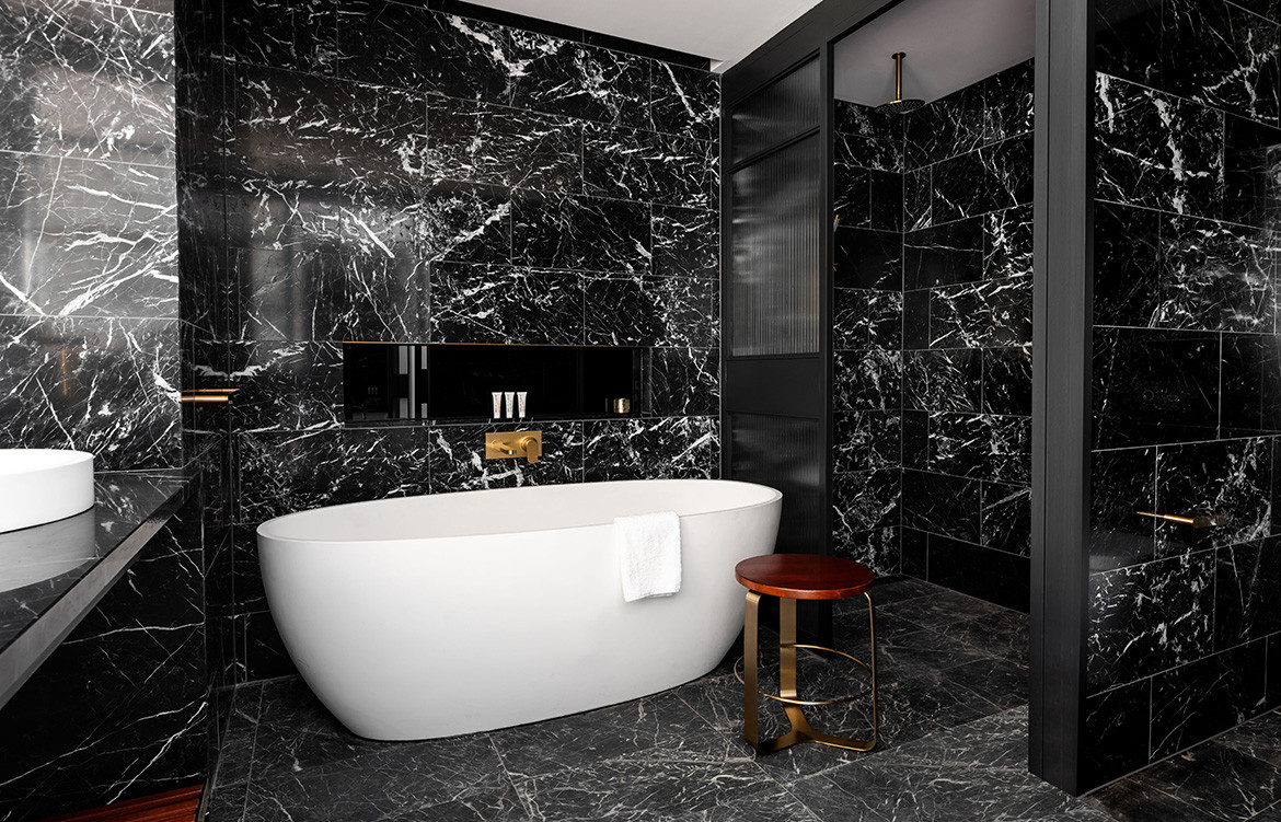 QT Hotel Perth Indyk Architecture bathtub black marble tiles ensuite