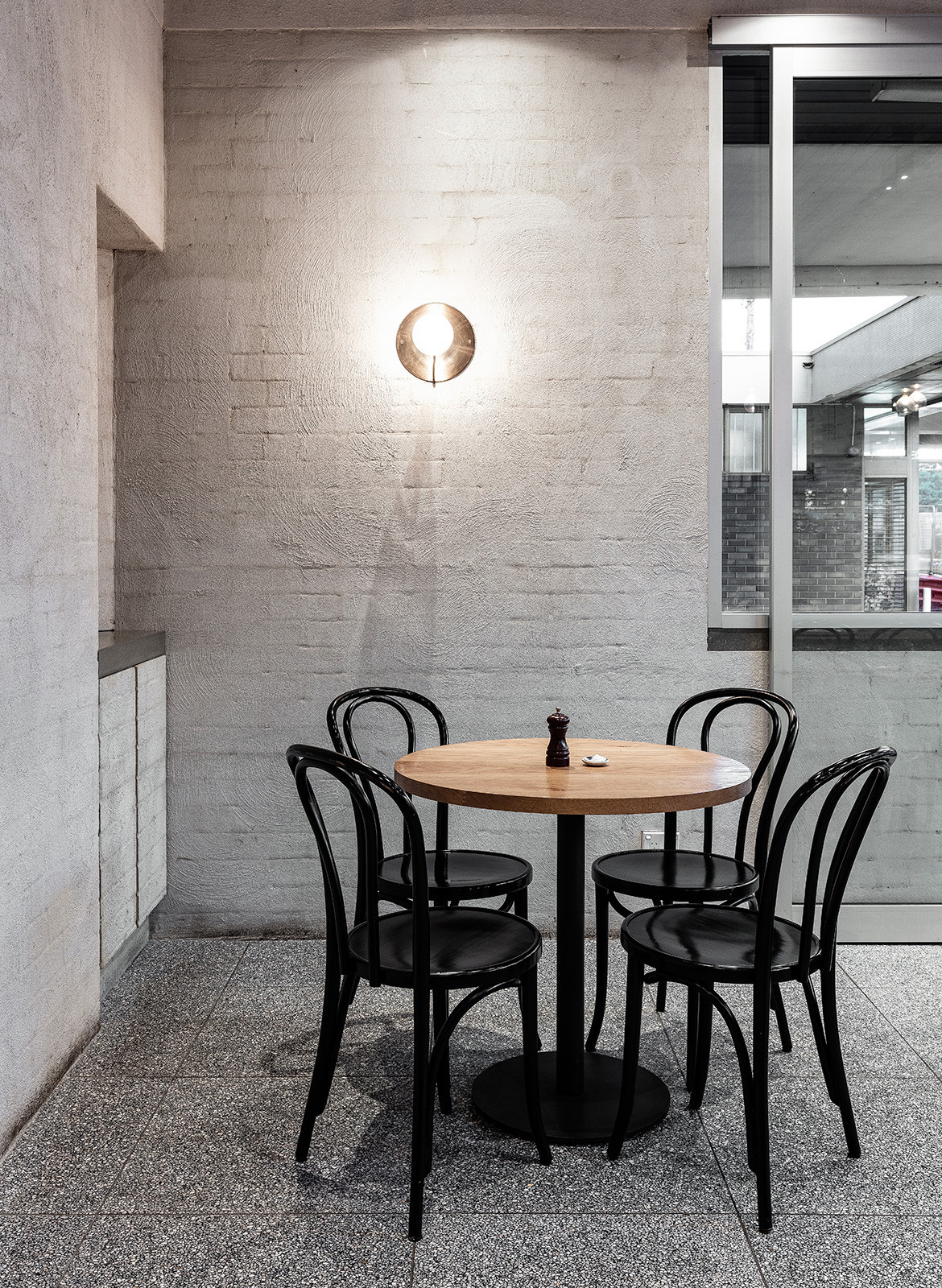 Ricco Bloch High St Cafe Randwick round table lighting detail